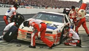 Allen Kulwicki makes pitstop at Atlanta Motor Speedway with Davey Allison in background